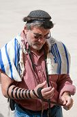 JERUSALEM, ISRAEL - MARCH 14: Man dressed in tallit and tefillin prays at the Wailing Wall.