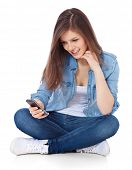 image of scandinavian descent  - Attractive teenage girl using mobile phone - JPG