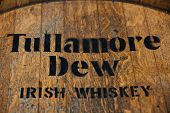 DUSSELDORF, GERMANY - SEPTEMBER 4, 2013: Tullamore Dew Irish whiskey brandmark on rustic whiskey jar.