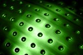 green spherical metal surface background with repetition holes