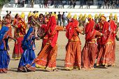 PUSHKAR, INDIA - NOVEMBER 21: Indian girls in colorful ethnic attire dancing at Pushkar camel fair on November 21, 2012 in Pushkar, Rajasthan, India.