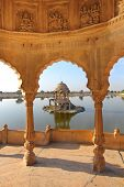 stock photo of jainism  - old jain cenotaphs on lake in jaisalmer rajasthan india - JPG