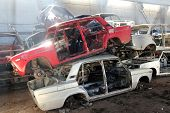 heap of cars is returned for recycling as scrap metal