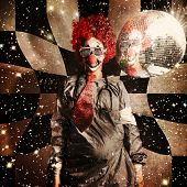 stock photo of distortion  - Crazy dancing disco clown on a psychedelic trip of distortion raving underneath a spinning mirror ball in retro shades - JPG