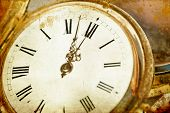Old golden clock on vintage background