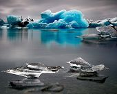 Blue Iceberg landscape Iceland at Joulsarlon glacier lagoon drifting pack ice due to melting caused by global warming beautiful arctic travel and tourism location cold wilderness