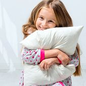 picture of pajamas  - beautiful little girl in pajamas with a pillow in his hands - JPG
