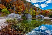 A Beautiful Pool with Bright Fall Foliage at Lost Maples State Park, Texas