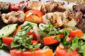 stock photo of kababs  - Beets of chicken and meat on pita bread - JPG