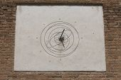 picture of sundial  - an old sundial on the wall at sun - JPG