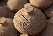 Traditional handmade clay moneybox