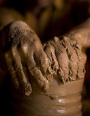 pic of loam  - close up hands of potter do a clay pot - JPG