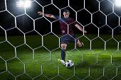 Hispanic Soccer Payer scoring during a game