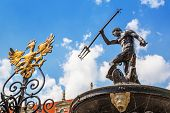 GDANSK, POLAND - 20 MAY: Fountain of the Neptune in old town of Gdansk on 20 May 2014. The bronze st
