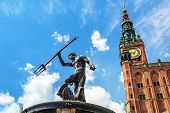 GDANSK, POLAND - 20 MAY: Fountain of the Neptune in old town of Gdansk on 20 May 2014. The bronze statue of Neptune made in 16th century is one the most recognizable symbols of Gdansk.
