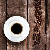 Black Coffee Cup And Roasted  Coffee Beans On Old Wooden Table With Copyspace,  Top View. Coffee Esp