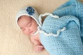 Sleeping Newborn Baby Girl Wearing A Light Blue Bonnet
