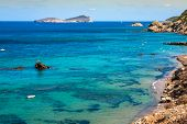foto of tanga  - Beautiful view of the azure water on the island of Ibiza in Europe - JPG