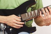 Guitarist playing the electric guitar closeup