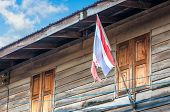 Old Thai Flag In Front Of Thai House In Rural