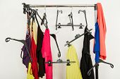 image of untidiness  - Untidy wardrobe with colorful summer outfits and accessories - JPG