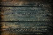 Grunge dark wood texture or background shimmer
