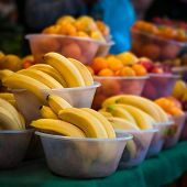 Outdoor farmer's market selling fruit in bowls