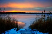 Winter sunset on a frozen lake