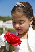 Young Girl With Crown And A Red Rose