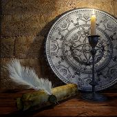 ancient still life with candle and scroll concept background