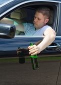 Driving Under The Influence. Male Hand With Bottle Of Beer.