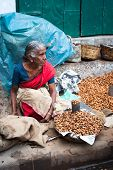 Indian women selling peanuts at street market place