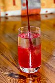 Glass In Flowing Strawberry Juice