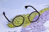 Glasses on a map of europe - Norway