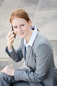Female Business Leader Calling By Phone
