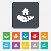 House insurance sign. Hand holds home symbol.