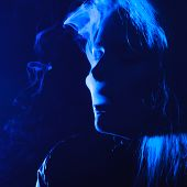 Woman With Cigarette And Smoke