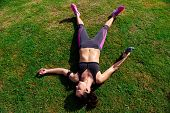 stock photo of breathing exercise  - exhausted runner after fitness running workout catching breath - JPG