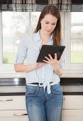 Attractive young woman using tablet device