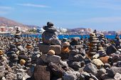 Stack of stones on beach in Tenerife island - Canary Spain