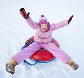 picture of toboggan  - Child sledding in winter hill - JPG