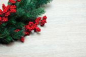 branch of Christmas tree on a wooden surface