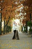 Mature couple dancing in park