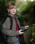 Girl In The Woods Navigating Using A Handheld Gps