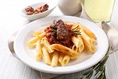 Tasty pasta with meat on table