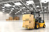 stock photo of lift truck  - Forklift truck in warehouse or storage loading cardboard boxes - JPG