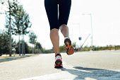 Runner Feet Running On Road Closeup On Shoe.