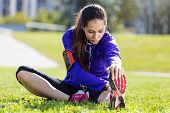 Young Woman Stretching And Preparing For Running
