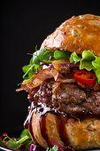 Delicious hamburger on dark background