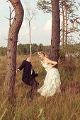 Bride threatens your wedded husband with a stick